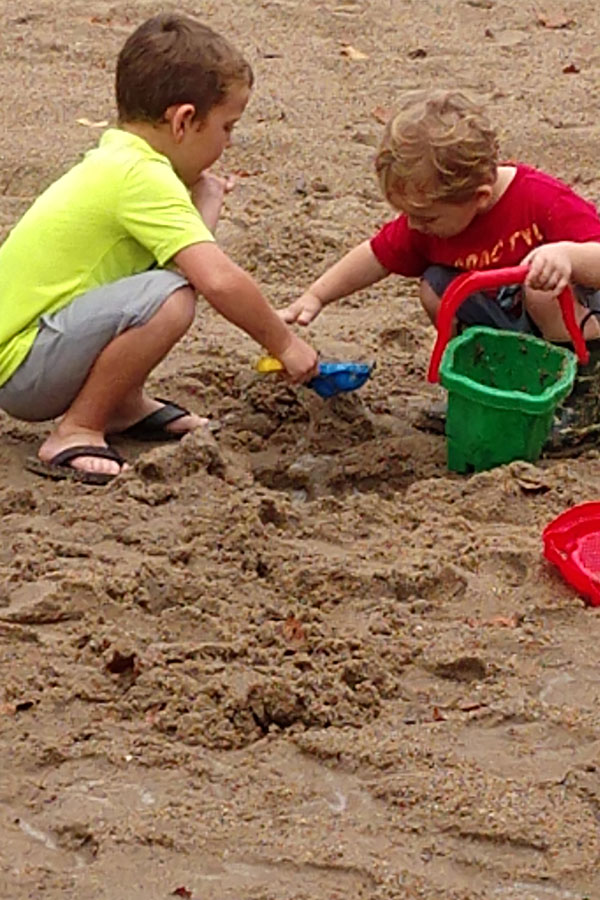 2 boys playing in the sand
